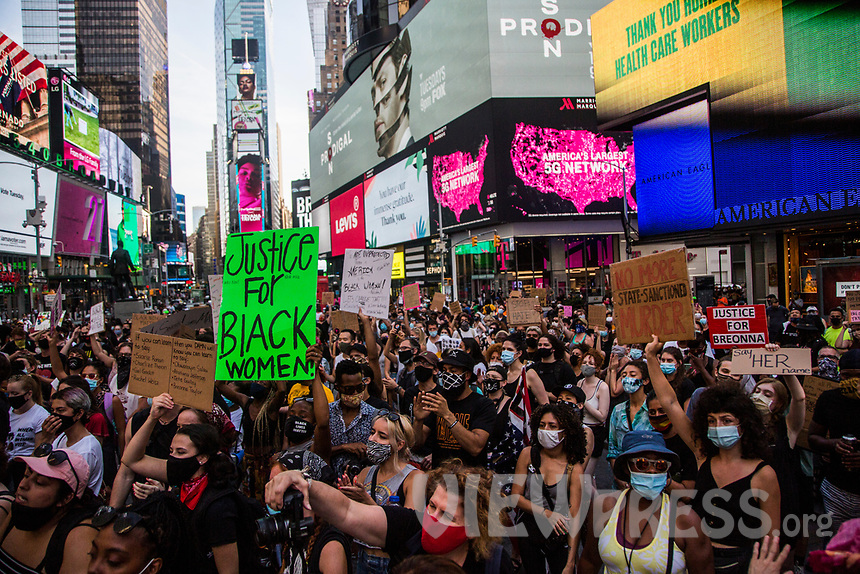 """NEW YORK, NY - JULY 26: A crowd of protesters gathers in Times Square in New York, NY on July 26, 2020. Hundreds of New York activists participated in a march to condemn what they see as an excessive focus of federal authorities in Portland, Oregon and continue to support the different movements of """"Black Lives Matter"""" (Photo by Pablo Monsalve / VIEWpress via Getty Images)"""