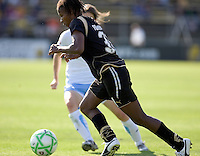 Formiga runs the ball past a Chicago defender. FC Gold Pride and Chicago Red Stars tied 1-1 at Buck Shaw Stadium in Santa Clara, California on June 7, 2009.
