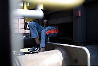 Pictured: A migrant man has slid himself in the under carriage of a train at the OSE freight depot in Thessaloniki, Greece. Wednesday 05 April 2017<br /> Re: A year after an agreement was signed between Greece and Turkey for the management of refugees. Migrants, mostly from Morocco, Algeria and Tunisia, have been living in disused train carriages at the Thessaloniki freight depot of OSE in northern Greece, the company managing the railways in the country. Some of the migrants climb onto moving trains, or even hide themselves in storage areas, hoping that they will cross the border.