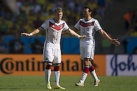 Bastian Schweinsteiger and Mats Hummels of Germany with their arms out
