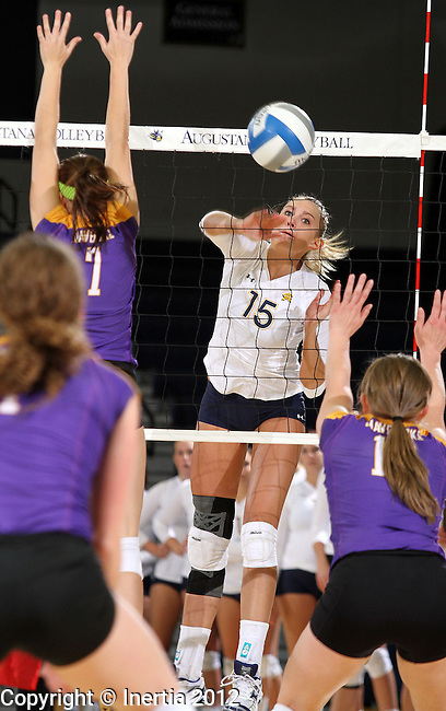 SIOUX FALLS, SD - OCTOBER 26:  Jordan Spatenka #15 from Augustana gets a kill past Tiana Runck #7 from Minnesota State University Mankato in the first game of their match Friday night at the Elmen Center. (Photo by Dave Eggen/Inertia)
