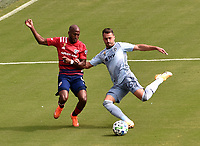 KANSAS CITY, KS - SEPTEMBER 19: Fafa Picault #9 of FC Dallas tries to stop Luis Martins #36 of Sporting Kansas City as he shoots on goal during a game between FC Dallas and Sporting Kansas City at Children's Mercy Park on September 19, 2020 in Kansas City, Kansas.