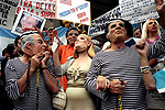 Economic Turmoil in Argentina<br /> Demonstrators outside the Supreme Courthouse in Buenos Aires. They are wearing masks, prison uniforms and represent members of the senate. The woman represents ex president Carlos Menem new Chilean wife Cecilla Bolocco.