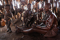 "The ritual for a bride is very involved... her entire body is buttered and covered with ochre clay.  The bride must stay in this condition in her husband's family's hut for ONE MONTH... or until she has her period.  This tribe will not allow marriage unless they are sure the husband will be the father of her children...I did not understand this dynamic on my first trip to the Omo valley.  But once I learned that these tribes have a sexual ""acting out"" period it became more clear.  A man with be bethrothed to a woman and then they WILL BOTH spend the next two years or so having sex with everyone EXCEPT the one they will marry.  Once the woman comes to the man's hut and they are formally married, they are supposed to only have sex with each other.  But in many cases the boyfriends and girlfriends from their two years are a much stronger draw than their arranged marriage... so they will continue to not only have relations with these boyfriends but they will also sometimes coordinate sex in such a way that their boyfriends are the fathers of their children instead of their husbands from the arranged marriage."