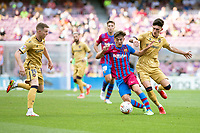 26th September 2021;   Nou Camp, Barcelona, Spain: La Liga football, FC Barcelona versus Levante: Gavi of Barcelona is challenged by García and Clerc of Levante