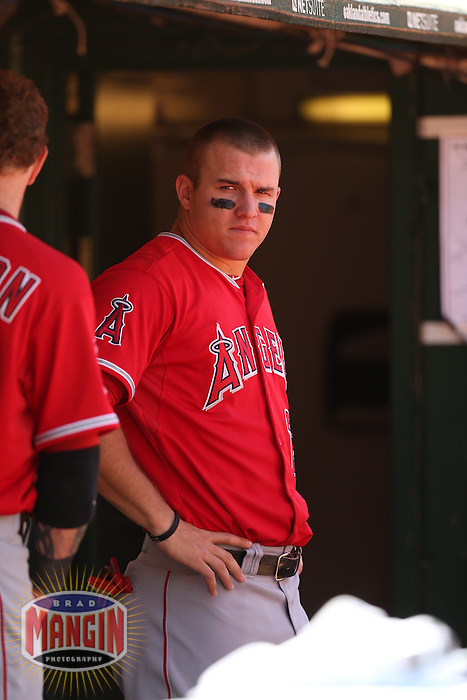 OAKLAND, CA - MAY 1:  Mike Trout #27 of the Los Angeles Angels watches from the dugout during the game against the Oakland Athletics at O.co Coliseum on May 1, 2013 in Oakland, California. Photo by Brad Mangin