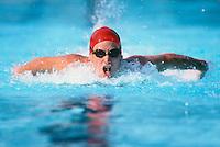 A butterfly swimmer in full flight