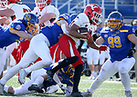 BROOKINGS, SD - MARCH 13: Jaleel McLaughlin #8 of the Youngstown State Penguins is brought down by a host of defenders from the South Dakota State Jackrabbits at Dana J. Dykhouse Stadium on March 13, 2021 in Brookings, South Dakota. (Photo by Dave Eggen/Inertia)