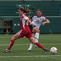 Canada's Emily Zurrer (2) and USWNT's Abby Wambach (20) battle for the ball. The U.S. Women's National Team defeated 1-0 in a friendly match at Marina Auto Stadium in Rochester, NY on July 19, 2009. Abby Wambach of the USWNT scored her 100th career goal in the second half..