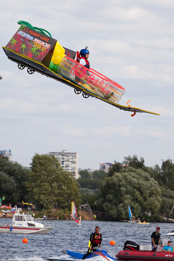 Moscow Russia, 07/08/2011..A homemade aircraft flies briefly before crashing at Red Bull Flugtag, when some 100,000 people gathered to watch a variety of makeshift aircraft launched over and into the Moscow river.