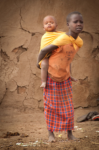 At about ten years a Masai girl is very much nearing the age of full responsibility. As they enter puberty, female genital mutilation (FGM), or circumcision will be performed as part of the rite of initiation to adulthood.  Presently this tradition is prohibited by Kenyan law but it is difficult to enforce these private ceremonies. Traditionally they would be married off immediately after circumcision, sometimes as early as nine years of age.  With the encouragement of human rights organizations who educated the parents and girls of the effects - emotional and physical - of circumcision, many girls now are refusing FGM and opting to continue with school.