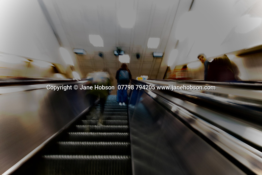 London, UK. 02.02.2020. Motion blur on the escalators, coming up from the Underground, London, UK. Photograph © Jane Hobson.