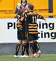 "Alloa""s Greig Spence (9) celebrates with Michael Doyle and Liam Buchanan (11) after he scores their first goal."