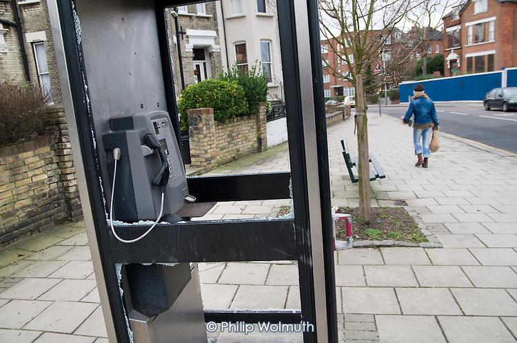 Vandalised British Telecom phone box, West Hampstead, London.