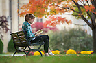 November 3, 2016; A student reads on a bench in the Main Quad. (Photo by Barbara Johnston/University of Notre Dame)