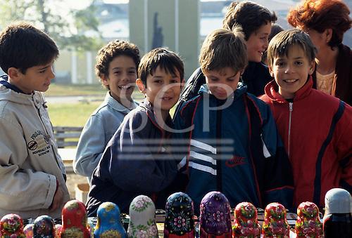 Sofia, Bulgaria. School children looking at a stall selling babushka dolls.