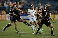Carrie Dew (left), Aly Wagner (4), and Leigh Ann Robinson (7) struggle for control of the ball. LA Sol and FC Gold Pride tied 0-0 at Buck Shaw Stadium in Santa Clara, California on July 23, 2009.