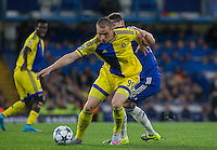 Dejan Radonjić (on loan from Dinamo Zagreb) of Maccabi Tel Aviv holds off Gary Cahill of Chelsea during the UEFA Champions League match between Chelsea and Maccabi Tel Aviv at Stamford Bridge, London, England on 16 September 2015. Photo by Andy Rowland.