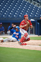 GCL Nationals catcher Alex Dunlap (27) checks the runner as Guillermo Granadillo (90) slides into home during the second game of a doubleheader against the GCL Mets on July 22, 2017 at The Ballpark of the Palm Beaches in Palm Beach, Florida.  GCL Mets defeated the GCL Nationals 4-1.  (Mike Janes/Four Seam Images)