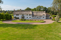 BNPS.co.uk (01202 558833)<br /> Pic: Savills/BNPS<br /> <br /> Pictured: The front of the property.<br /> <br /> A historic thatched home where Cromwell's army stayed during the English Civil War is on the market for £1.6m.<br /> <br /> The Barracks, so-named for its links with Cromwell more than 370 years ago, has spectacular country views and is in one of Cheshire's most popular areas.<br /> <br /> The five-bedroom property just outside the picturesque village of Bunbury is a far cry from how it would have looked in Cromwell's time, having been extended over the years.<br /> <br /> It was used in the 17th century by Cromwell's armies during the siege of Beeston Castle - two miles away. The castle's location made it valuable to both the royalists and parliamentarians.