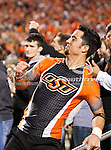 Oklahoma State Cowboys cheerleaders in action during the game between the Oklahoma Sooners and the Oklahoma State Cowboys at the Boone Pickens Stadium in Stillwater, OK. Oklahoma State defeats Oklahoma 44 to 10..