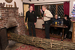 Burning the Ashen Faggot old New Years Eve. 6 January 2020. The Squirrel Inn Laymore Dorset, UK . Similar to  a Christmas Yule log thats burnt on Christmas Eve and put whole into the hearth of a fireplace. In Laymore the Ashen Faggot is approximately 15 feet long and bound in 12 sections with twelve green lengths of hazel bands or 'beams' one section representing each day after Christmas. Publican Gerald Hobbs and local farmer Mike Turner, who's been making the Ashen Faggot for over 45 years.
