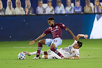 CARSON, CA - SEPTEMBER 19: Joe Corona #15 of the Los Angeles Galaxy tackles Kellyn Acosta #10 of the Colorado Rapids during a game between Colorado Rapids and Los Angeles Galaxy at Dignity Heath Sports Park on September 19, 2020 in Carson, California.