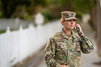 US Military Off Duty woman using cell phone outside. Model released, DOD compliant for commercial use.