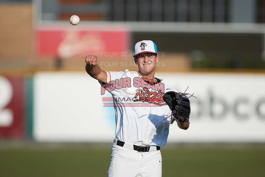 Jacob Speaker (33) (TCU) of the Burlington Sock Puppets warms up in the outfield prior to the game against the Danville Otterbots at Burlington Athletic Park on June 5, 2021 in Burlington, North Carolina. (Brian Westerholt/Four Seam Images)