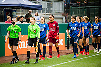 TACOMA, WA - JULY 31: OL Reign enter the pitch before a game between Racing Louisville FC and OL Reign at Cheney Stadium on July 31, 2021 in Tacoma, Washington.