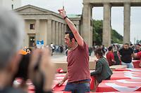 """Der tuerkische Verein """"Hacivat"""" organisierte am Montag den 15. Juli 2019 in Berlin ein Gedenken an die Opfer des Putsches am 15. Juli 2016. Die nationalistischen Erdogananhaenger (Eigenbezeichnung) und Sympathisanten der faschistischen """"Grauen Woelfe"""" stellten 251 symbolische Saerge vor dem Brandenburger Tor auf.<br /> Im Bild: Bilgili Ueretmen aus Soest, Organisator der Veranstaltung, zeigt in Richtung Gegendemonstranten den sog. Wolfsgruss, das Zeichen der faschistischen Organisation """"Graue Woelfe"""".<br /> 15.7.2019, Berlin<br /> Copyright: Christian-Ditsch.de<br /> [Inhaltsveraendernde Manipulation des Fotos nur nach ausdruecklicher Genehmigung des Fotografen. Vereinbarungen ueber Abtretung von Persoenlichkeitsrechten/Model Release der abgebildeten Person/Personen liegen nicht vor. NO MODEL RELEASE! Nur fuer Redaktionelle Zwecke. Don't publish without copyright Christian-Ditsch.de, Veroeffentlichung nur mit Fotografennennung, sowie gegen Honorar, MwSt. und Beleg. Konto: I N G - D i B a, IBAN DE58500105175400192269, BIC INGDDEFFXXX, Kontakt: post@christian-ditsch.de<br /> Bei der Bearbeitung der Dateiinformationen darf die Urheberkennzeichnung in den EXIF- und  IPTC-Daten nicht entfernt werden, diese sind in digitalen Medien nach §95c UrhG rechtlich geschuetzt. Der Urhebervermerk wird gemaess §13 UrhG verlangt.]"""