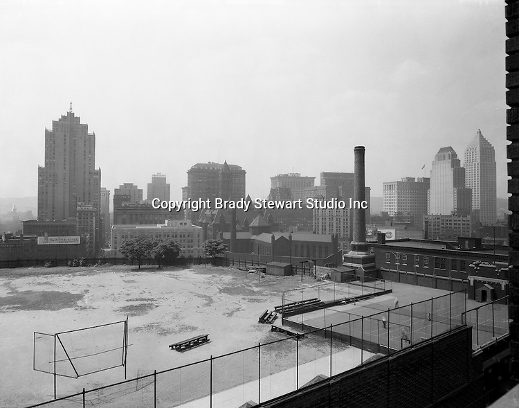 Pittsburgh PA:  View of Pittsburgh and the Monongahela River from the bluff at Duquesne University.<br /> The Grant Building (left)), Frick Building (next to Grant Bldg), Oliver Building (center foreground), Arrott Building (between Grant and Frick buildings), and the relatively new Koppers and brand new Gulf Buildings (far right) are in the shot