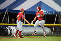 Williamsport Crosscutters coach Carlos Alonso (6) congratulates Darick Hall (46) after hitting a home run during a game against the Batavia Muckdogs on September 1, 2016 at Dwyer Stadium in Batavia, New York.  Williamsport defeated Batavia 10-3. (Mike Janes/Four Seam Images)