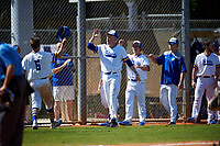 South Dakota State Jackrabbits Logan Holtz (6) high fives Tyler Olmstead after scoring a run during a game against the FIU Panthers on February 23, 2019 at North Charlotte Regional Park in Port Charlotte, Florida.  South Dakota State defeated FIU 4-3.  (Mike Janes/Four Seam Images)