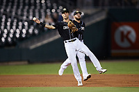 Charlotte Knights shortstop Zach Remillard (7) makes a throw to first base against the Norfolk Tides at Truist Field on August 19, 2021 in Charlotte, North Carolina. (Brian Westerholt/Four Seam Images)