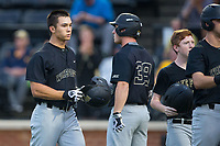 Stuart Fairchild (4) of the Wake Forest Demon Deacons walks back to the dugout after hitting a grand slam against the West Virginia Mountaineers in Game Six of the Winston-Salem Regional in the 2017 College World Series at David F. Couch Ballpark on June 4, 2017 in Winston-Salem, North Carolina.  The Demon Deacons defeated the Mountaineers 12-8.  (Brian Westerholt/Four Seam Images)