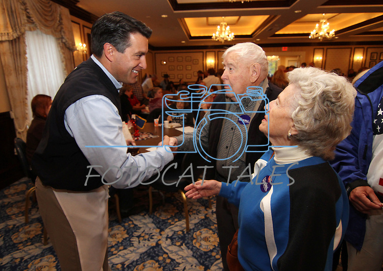 Gubernatorial candiate Brian Sandoval talks with former Carson City mayor Harold Jacobsen and his wife Alice during the annual Carson City Republican Women's Nevada Day Pancake Breakfast at the Governor's Mansion on Saturday morning, Oct. 30, 2010, in Carson City, Nev. .Photo by Cathleen Allison