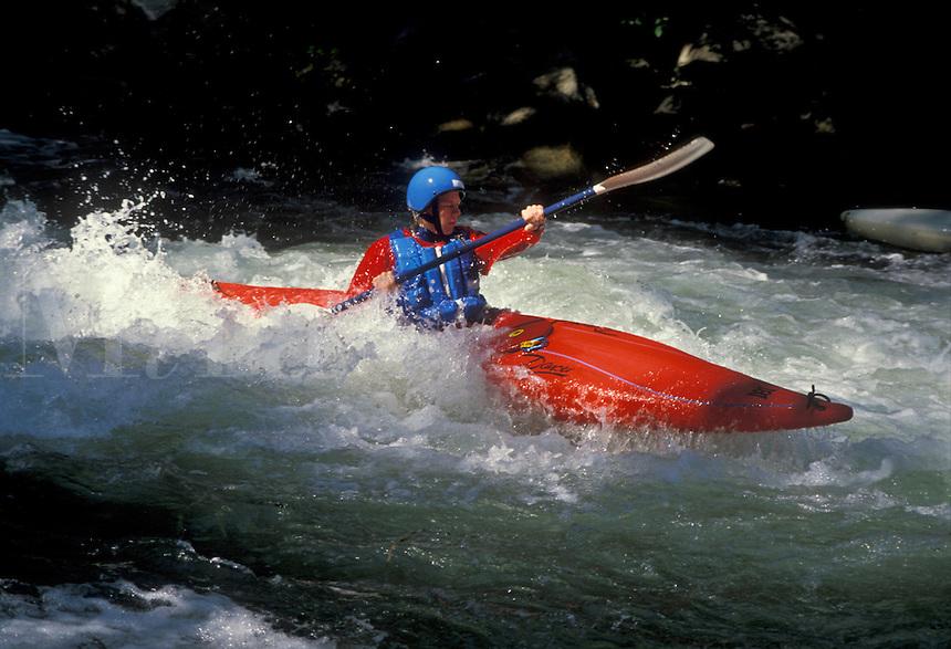 AJ1721, kayaking, white water, North Carolina, Man kayaking in a red kayak in white water on the Nantahala River in the Appalachian Mountains.