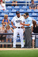 Binghamton Rumble Ponies manager Luis Rojas (19) talks with home plate umpire Derek Gonzales during a game against the Hartford Yard Goats on July 9, 2017 at NYSEG Stadium in Binghamton, New York.  Hartford defeated Binghamton 7-3.  (Mike Janes/Four Seam Images)