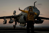 111217-N-DR144-277 PACIFIC OCEAN (Dec. 17, 2011) Aviation Boatswain's Mate (Handling) 3rd Class Tilford Breedlove directs an EA-6B Prowler assigned to Electronic Attack Squadron (VAQ) 134 away from the landing area after an arrested landing on the flight deck aboard Nimitz-class aircraft carrier USS Carl Vinson (CVN 70). Carl Vinson and Carrier Air Wing (CVW) 17 are currently underway on a Western Pacific deployment.  (U.S. Navy photo by Mass Communication Specialist 2nd Class James R. Evans/Released).