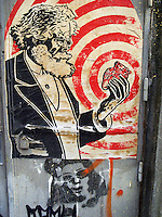 """Switzerland. Geneva. A poster on a wall from Karl Heinrich Marx, holding a heart in his left hand. Graffiti. Karl Heinrich Marx (May 5, 1818 - March 14, 1883) was a German philosopher, political economist, historian, political theorist, sociologist, communist, and revolutionary, whose ideas played a significant role in the development of modern communism. Marx argued that capitalism, like previous socioeconomic systems, would inevitably produce internal tensions which would lead to its destruction. Just as capitalism replaced feudalism, he believed socialism would, in its turn, replace capitalism, and lead to a stateless, classless society called pure communism. This would emerge after a transitional period called the """"dictatorship of the proletariat"""": a period sometimes referred to as the """"workers state"""" or """"workers' democracy"""" . 28.11.09  © 2009 Didier Ruef"""
