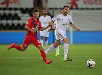 Pictured L-R: Callum Rzonca of York and Angel Rangel of Swansea Tuesday 25 August 2015<br /> Re: Capital One Cup, Round Two, Swansea City v York City at the Liberty Stadium, Swansea, UK.