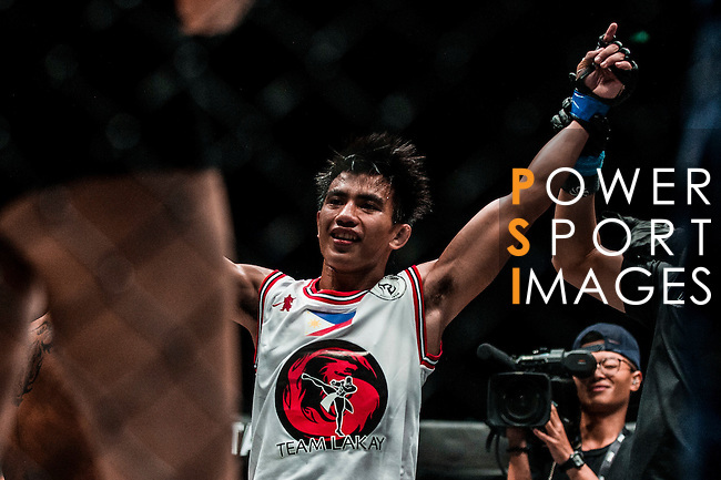 Straw weight World Championship Joshua Pacio of Philippines celebrates after winning Kritsada Kongsrichai of Thailand during the One Championship - Heroes of the World on August 13, 2016 in Macau, China. Photo by Marcio Machado / Power Sport Images