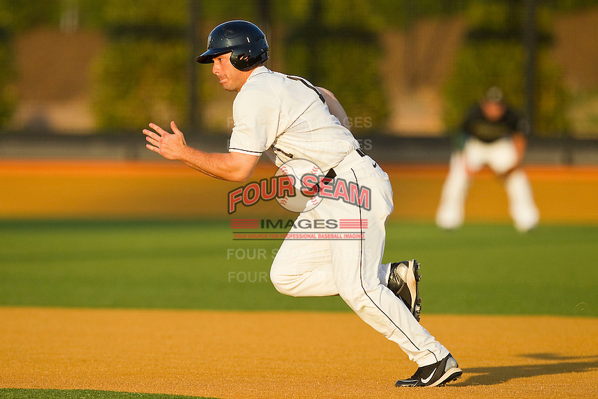 Steven Brooks #1 of the Wake Forest Demon Deacons takes off for second base against the Charlotte 49ers at Gene Hooks Field on March 22, 2011 in Winston-Salem, North Carolina.   Photo by Brian Westerholt / Four Seam Images