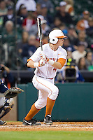 Kacy Clemens #42 of the Texas Longhorns follows through on his swing against the Rice Owls at Minute Maid Park on February 28, 2014 in Houston, Texas.  The Longhorns defeated the Owls 2-0.  (Brian Westerholt/Four Seam Images)