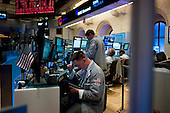 New York, New York<br /> August 18, 2011<br /> <br /> The New York Stock Exchange floor during trading as Dow Jones industrial average fell 419.63 points.<br /> <br /> After just a few days of calm, stock markets heaved again, sending major American indexes down as much as 5 percent on persistent worries about the economy and Europe's debt problems. <br /> <br /> Investors rushed into United States Treasuries as a safe haven, despite unease about how the government will address its deficit and economic slowdown.