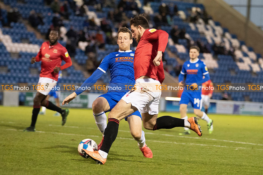 Cole Stockton of Morecambe prepares to shoot under pressure from Tom Eastman, Colchester United during Colchester United vs Morecambe, Sky Bet EFL League 2 Football at the JobServe Community Stadium on 19th December 2020