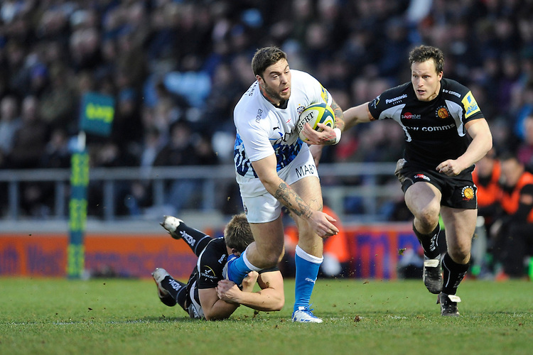 Matt Banahan of Bath Rugby looks for support as he offloads in the tackle as Bryan Rennie of Exeter Chiefs prepares to tackle him during the LV= Cup match between Exeter Chiefs and Bath Rugby at Sandy Park Stadium on Sunday 5th February 2012 (Photo by Rob Munro)