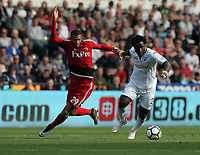 Wilfried Bony of Swansea City (R) moves away from Etienne Capoue of Watford during the Premier League match between Swansea City and Watford at The Liberty Stadium, Swansea, Wales, UK. Saturday 23 September 2017