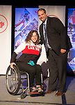 Calgary, AB - June 5 2014 - Kimberly Joines receives her Paralympic Ring from Rob Mason, of HBC, during the Celebration of Excellence Paralympic Ring Reception in Calgary. (Photo: Matthew Murnaghan/Canadian Paralympic Committee)